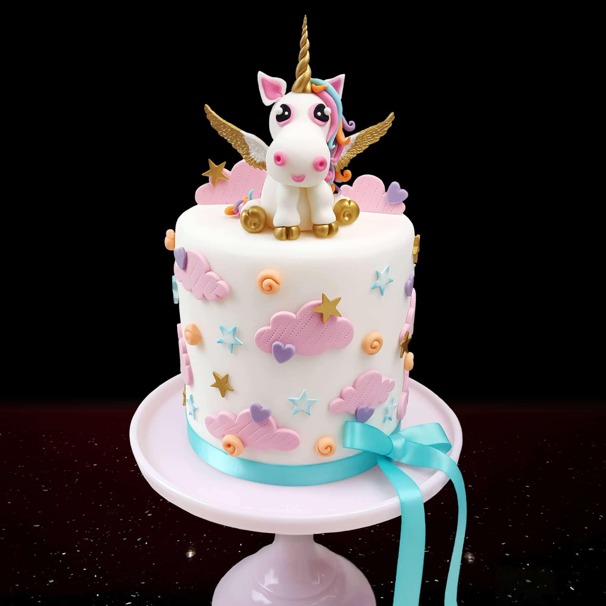 Little unicorn with golden wings cake design by Cake No Mistake