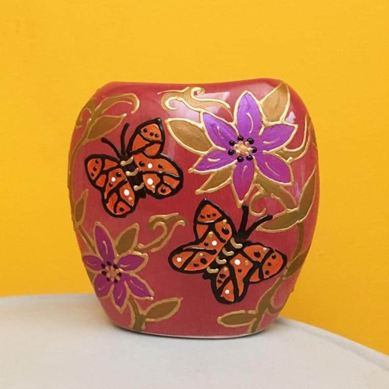Butterfly and flower design ceraic vase made by Hazlehurst Ceramics.