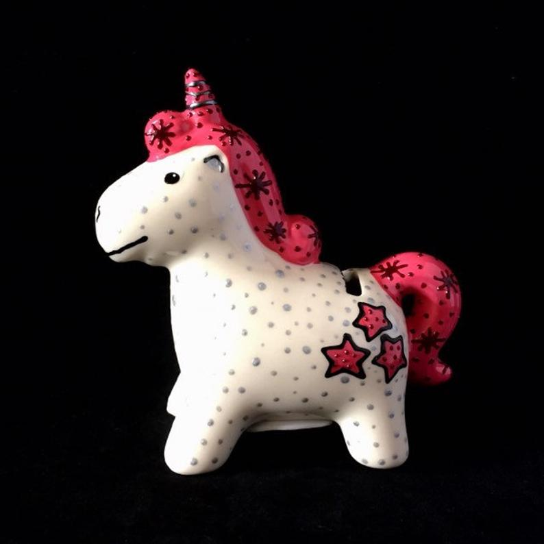 Ceramic unicorn piece made by our Crafter in the Spotlight Hazlehurst Ceramics.