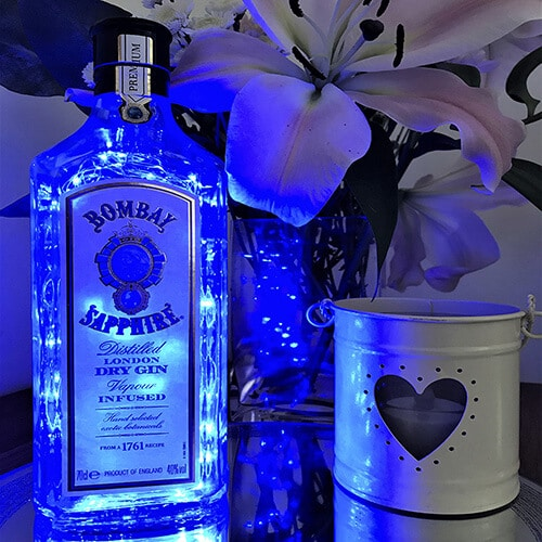 An empty bottle of Bombay Sapphire gin that has been upcycled into lights by The Bottle Bin.