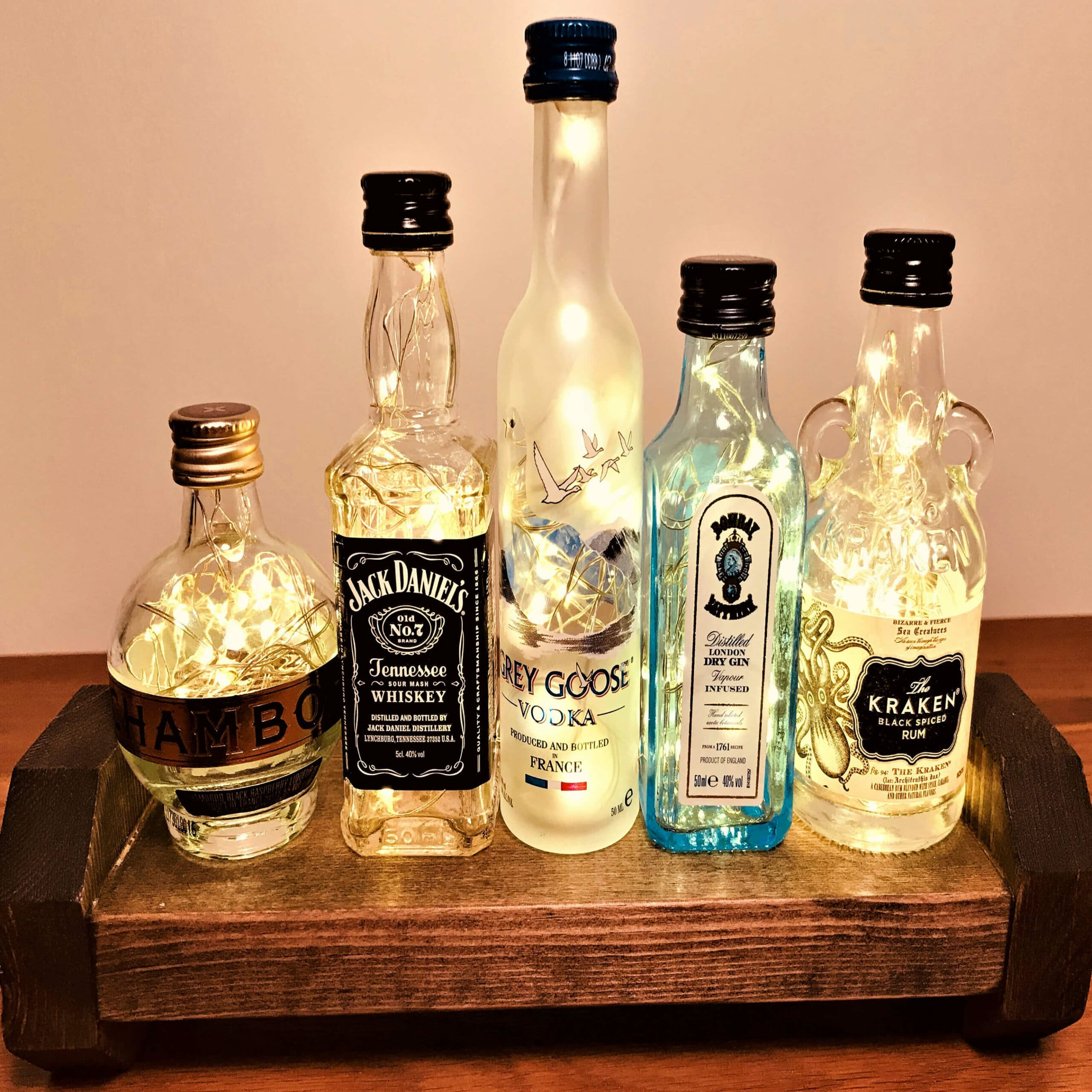 A selection of miniature bottles that have been upcycled into beautiful lights.