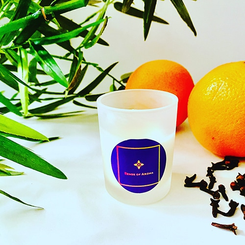 Orange, clove and cedar leaf candle which was handmade by Sense of Aroma.
