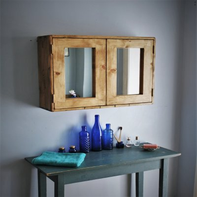 A wooden cabinet which has been handcrafted by Marc Wood Bespoke Joinery and installed in a bathroom.
