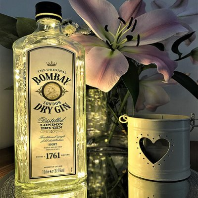 A bright and quirky upcycled Bombay Sapphire bottle which has been upcycled with lights.