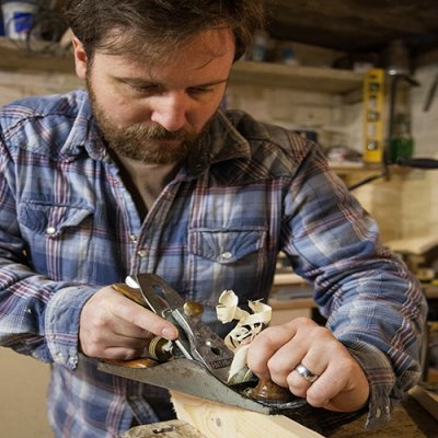 Owner of Marc Wood Bespoke Joinery making wooden crafts in his workshop.